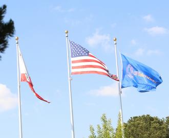 Flags at CSUB entrance